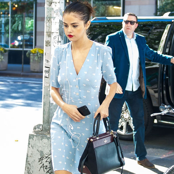 Selena Gomez wears a light blue day dress