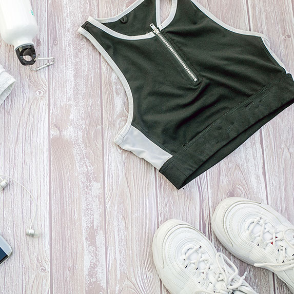 Flatlay of sneakers and workout gear.