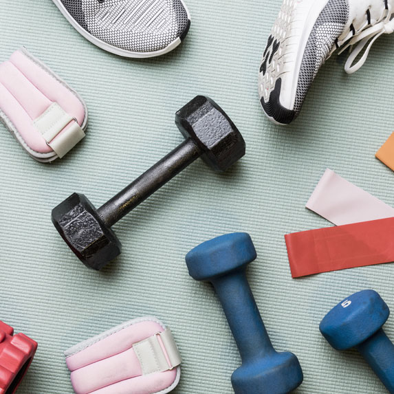 Flatlay of workout weights and sneakers.