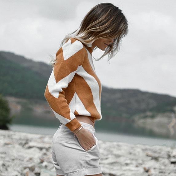 woman wearing sweater on a beach