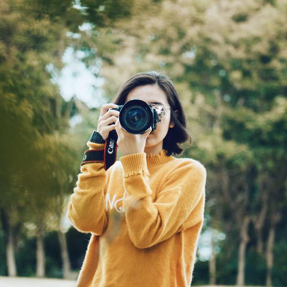Woman loving her camera