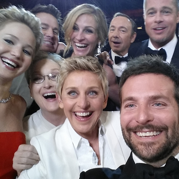 A celeb selfie taken at the Oscars featuring Ellen Degeneres, Jennifer Lawrence, Bradley Cooper, Meryl Streep, et al