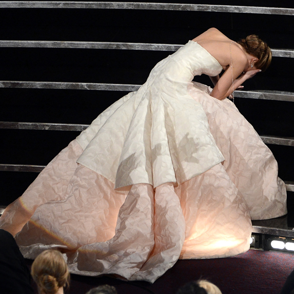 Jennifer Lawrence trips on her way to the podium to accept the award for Best Actress