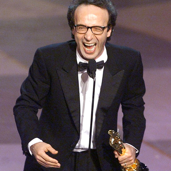 An enthused Roberto Benigni wins the first of his two Oscars