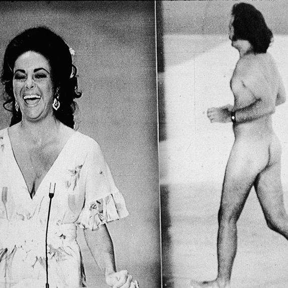 Elizabeth Taylor laughs as Robert Opel streaks across the stage during the 1974 Oscar telecast
