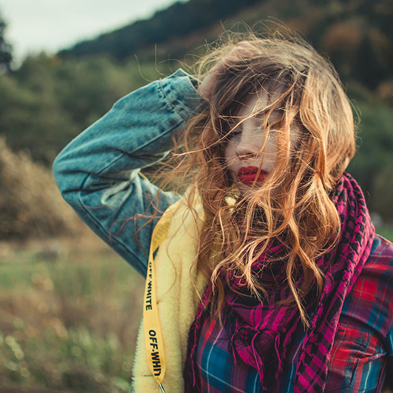 woman outside with long hair and scarf