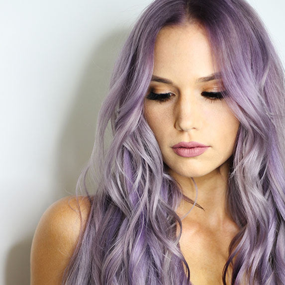 woman with purple hair looking down