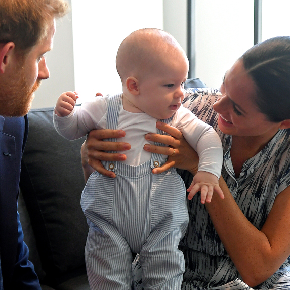 Harry and Meghan with Archie during a royal event