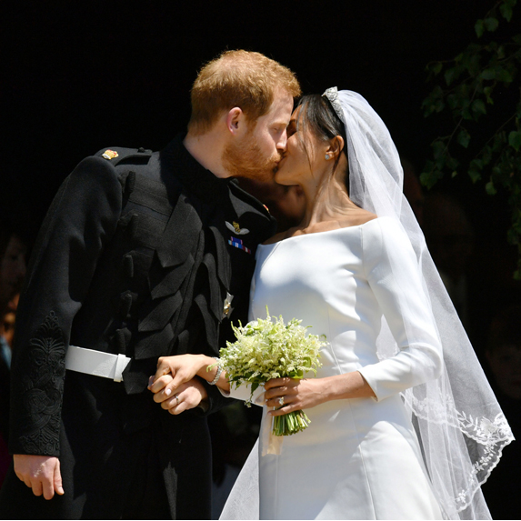 Meghan and Harry lock lips on the steps of St. George's Cathedral after they've exchanged vows