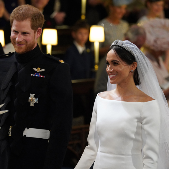 Harry and Meghan are all smiles during their televised nuptials
