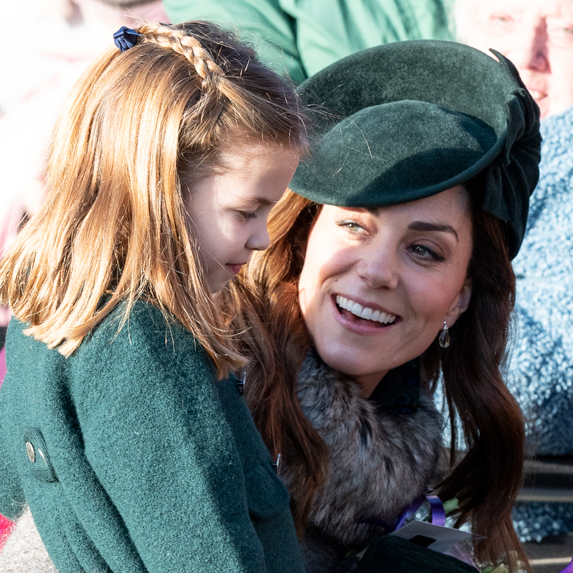 Kate Middleton with daughter, Princess Charlotte, greeting guests outside the church on Christmas Day 2019