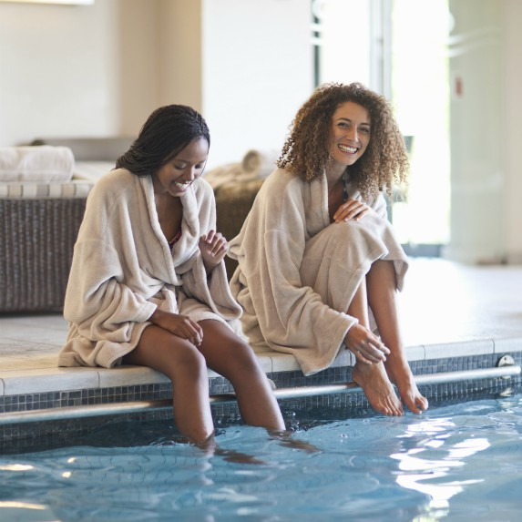 two women at a spa with feet in the water