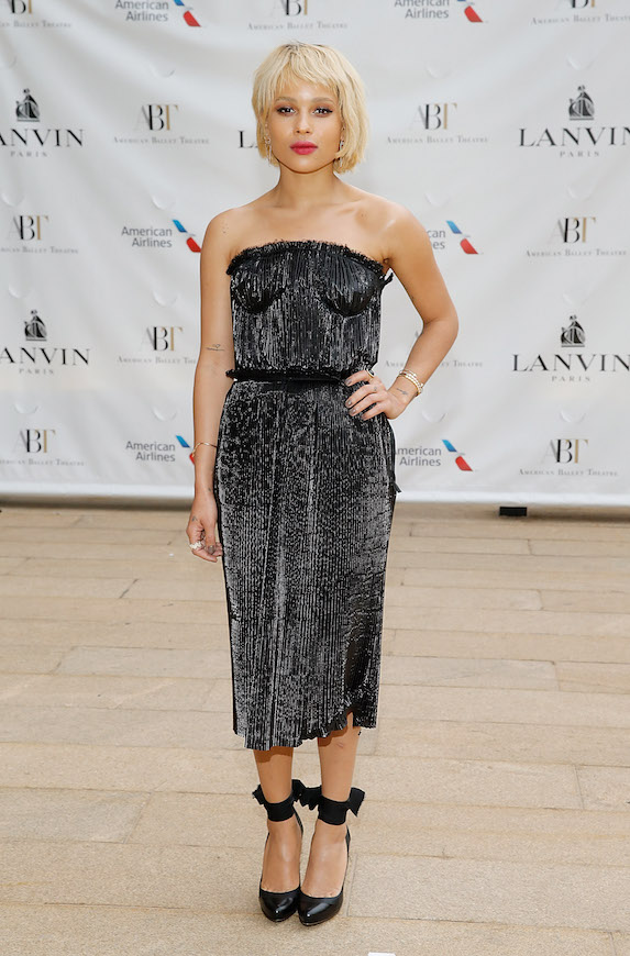 Zoe Kravitz styles her hair in a platinum-blonde bob, and wears a black midi-length dress and black heels to the American Ballet Theatre's Spring Gala in 2014