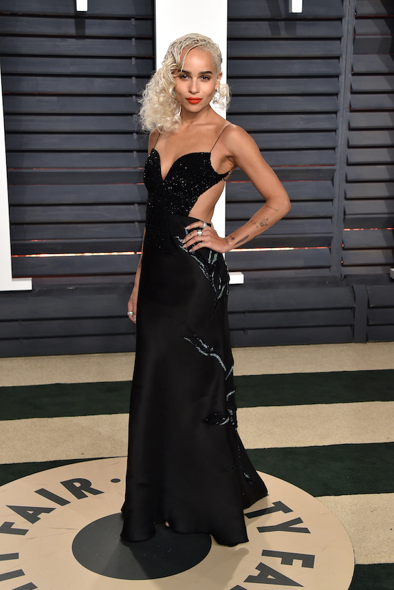 Zoe Kravitz wears a black cut-out gown, red lip and platinum blonde hairstyle to the 2017 Vanity Fair Oscar Party