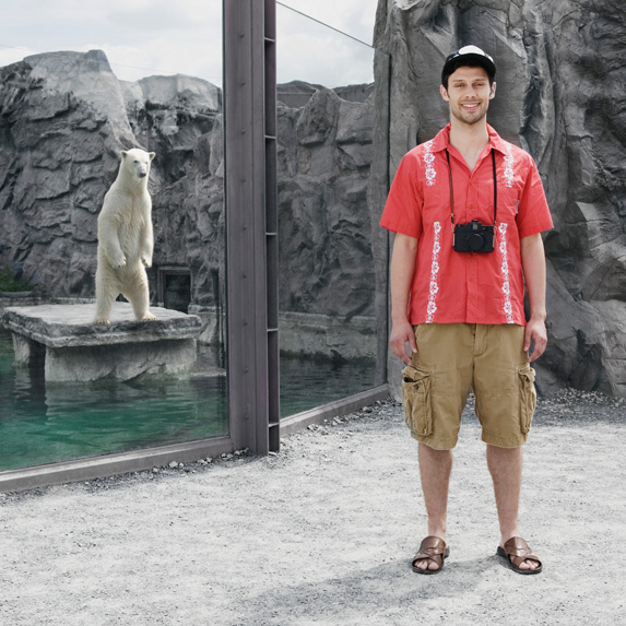Guy in shorts in front of a polar bear