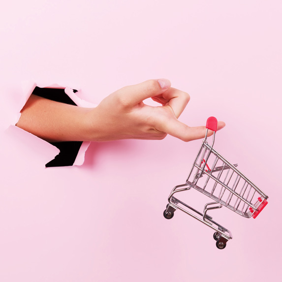 Shopping cart and woman's hand