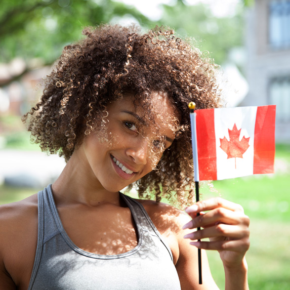 Woman holds a Canadian flag