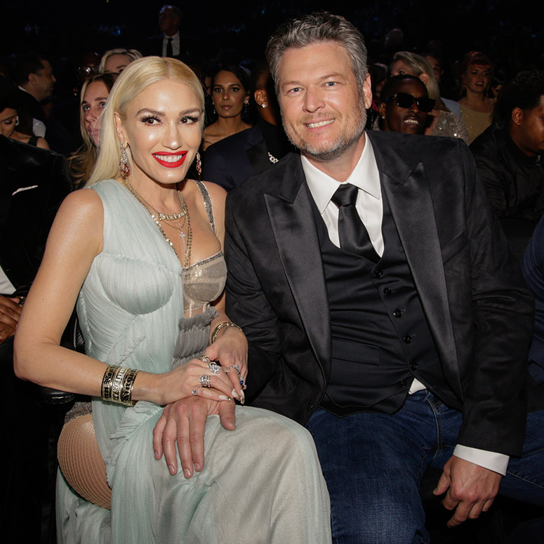 Gwen Stefani and Blake Shelton sitting at a show together