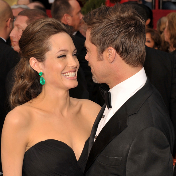 Angelina Jolie and Brad Pitt share a laugh on the red carpet