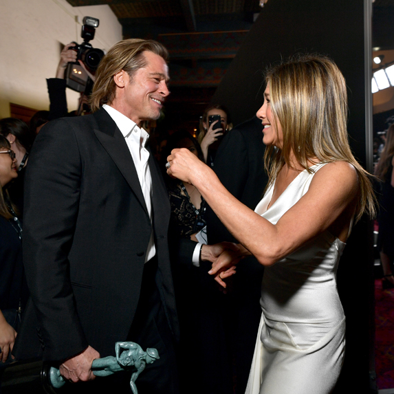 Brad Pitt and Jennifer Aniston congratulate each other backstage at the 2020 SAG Awards after both their wins
