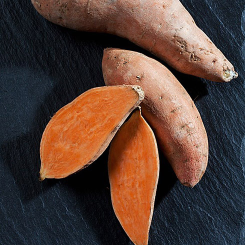 Two sweet potatoes and one cut in half