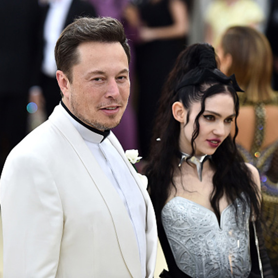 Grimes and Elon Musk standing side-by-side at the Grammy's