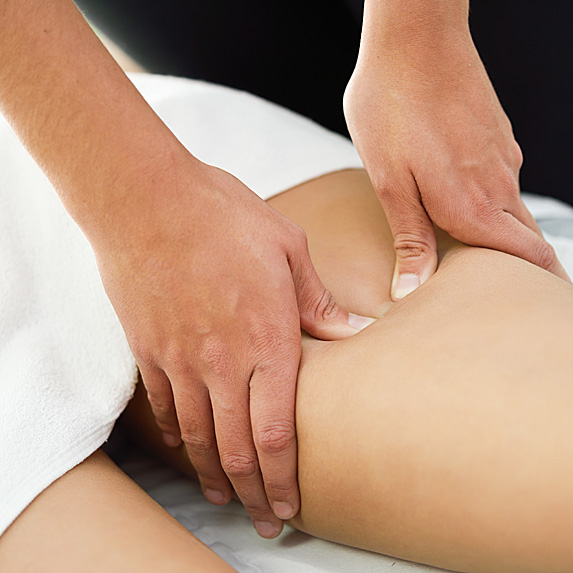 Woman's upper thigh getting massaged