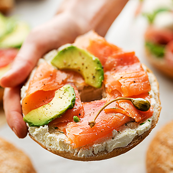 Whole wheat bagel with smoked salmon and avocado
