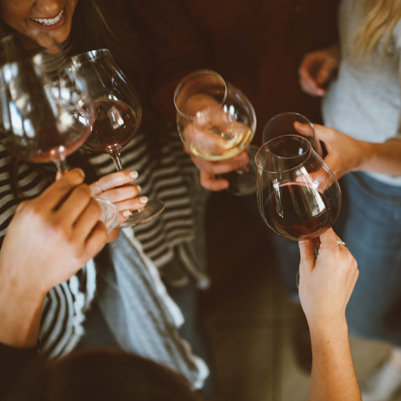 Networking event, people cheers with wine