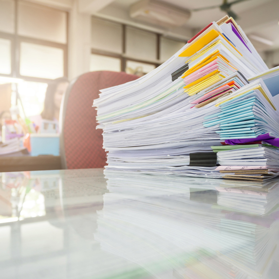 Stack of paperwork in an office