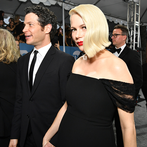 Michelle Williams and Thomas Kail mid-stride