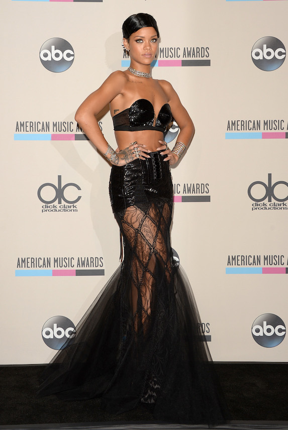 Rihanna wears a black sequin bra-and-skirt ensemble to the 2013 American Music Awards