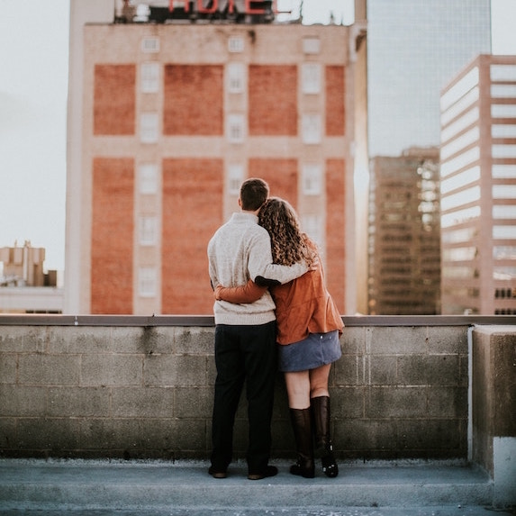 couple look over a rooftop