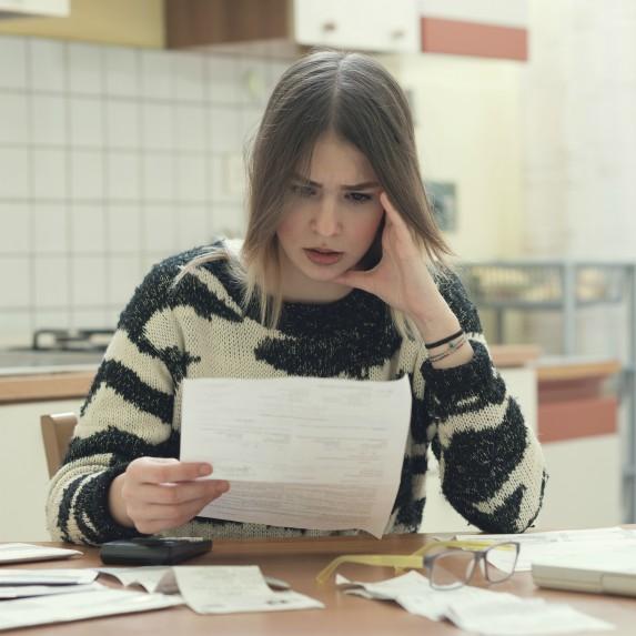 stressed-woman-looking-at-bills