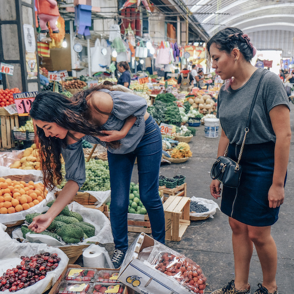 two women looking at fruit in the Mercado de Jamaica in Mexico City