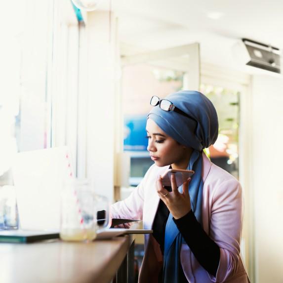 woman-wearing-hijab-using-phone