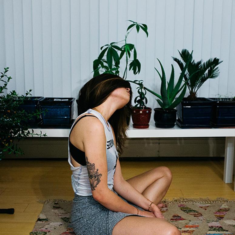 woman sitting on the floor, meditating