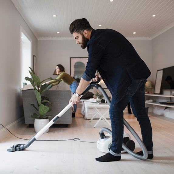 Man vacuuming