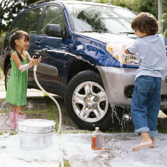 Kids washing a car