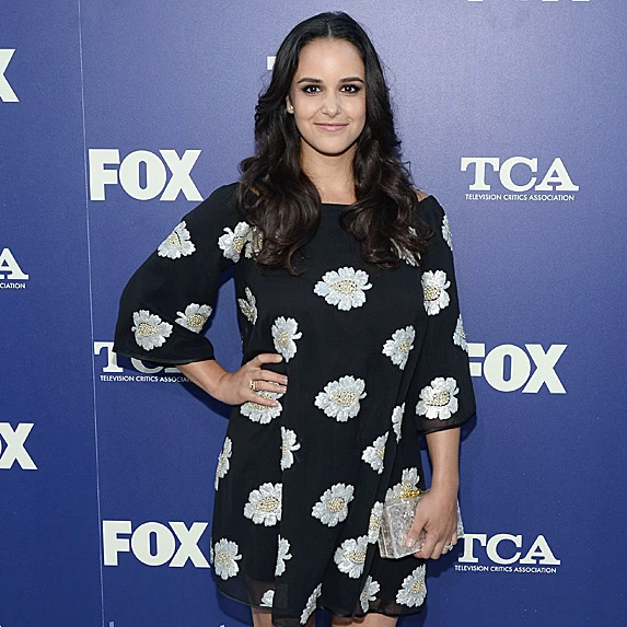 Melissa Fumero posing and smiling at an event