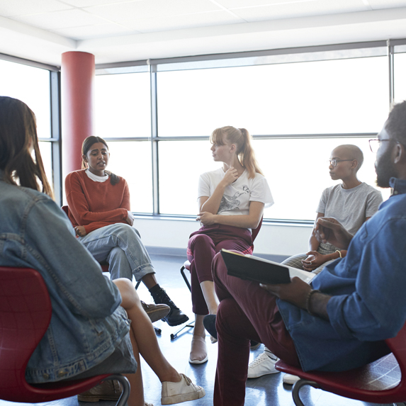 Mental health instructor in group meeting at classroom