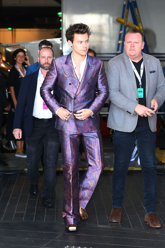 Harry Styles wears a shiny purple suit to the ARIA Awards in Sydney, Australia in 2017