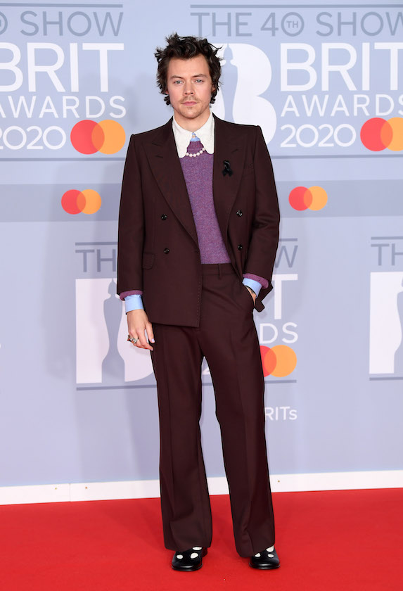 Harry Styles wears a purple suit to the Brit Awards in 2020