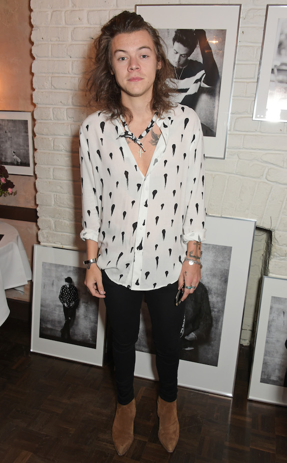 Harry Styles wears a white top and skinny pants to a private dinner launch event in 2015
