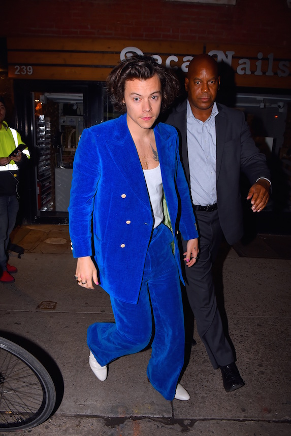 Harry Styles wears a bright blue, velvet suit in 2019