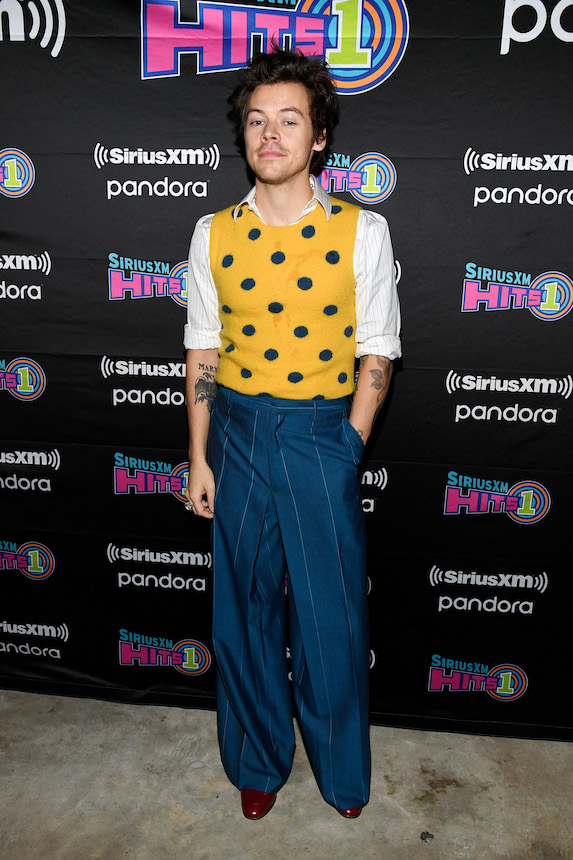 Harry Styles wears wide-leg pinstriped pants and a yellow vest in 2020