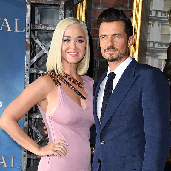 Katy Perry and Orlando Bloom posing at an event, all dressed up