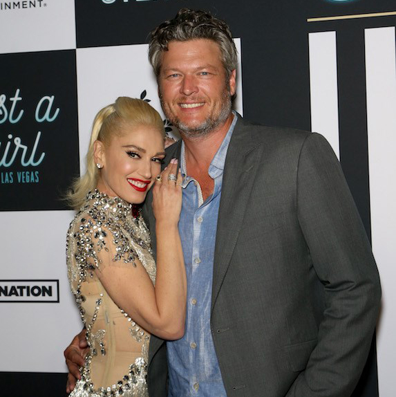 Blake Shelton and Gwen Stefani at an event, smiling for the cameras