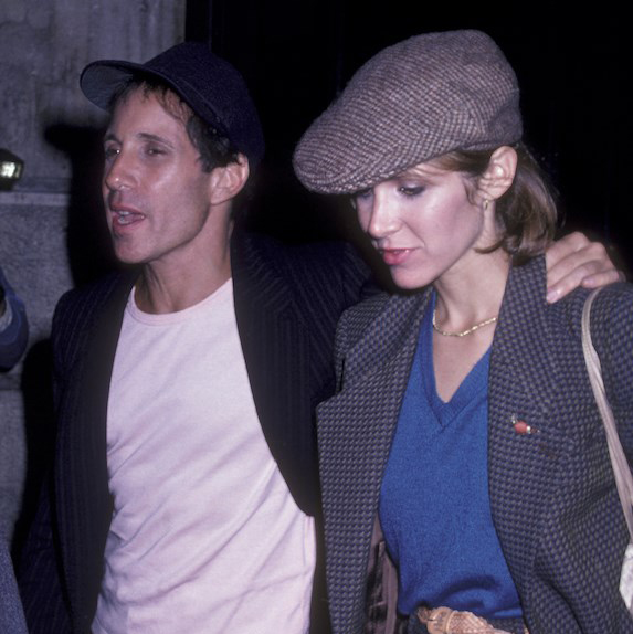 Carrie Fisher and Paul Simon, mid-stride