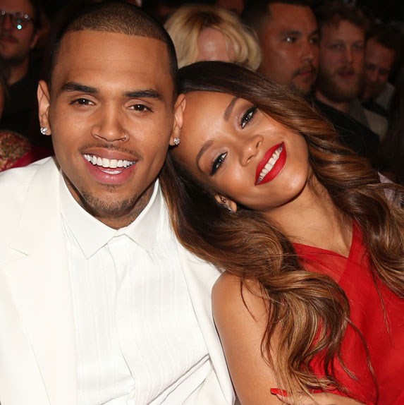 Rihanna leaning her head on Chris Brown